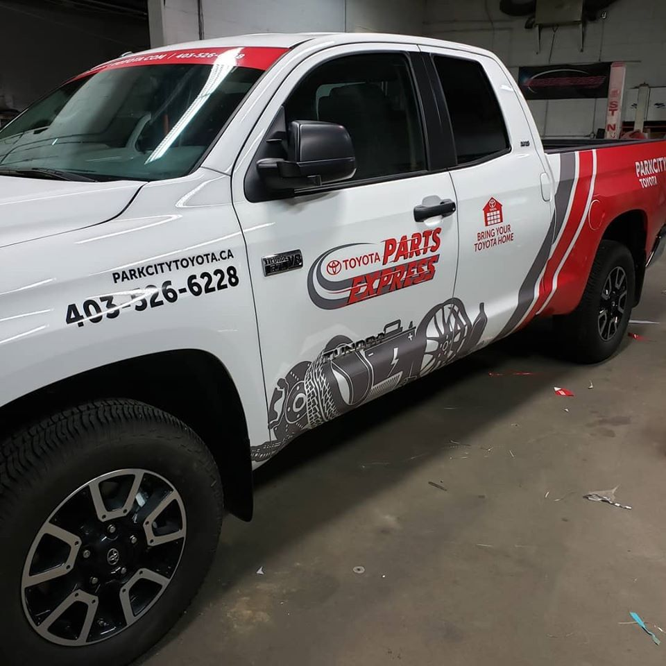 Truck with protective vehicle wrap