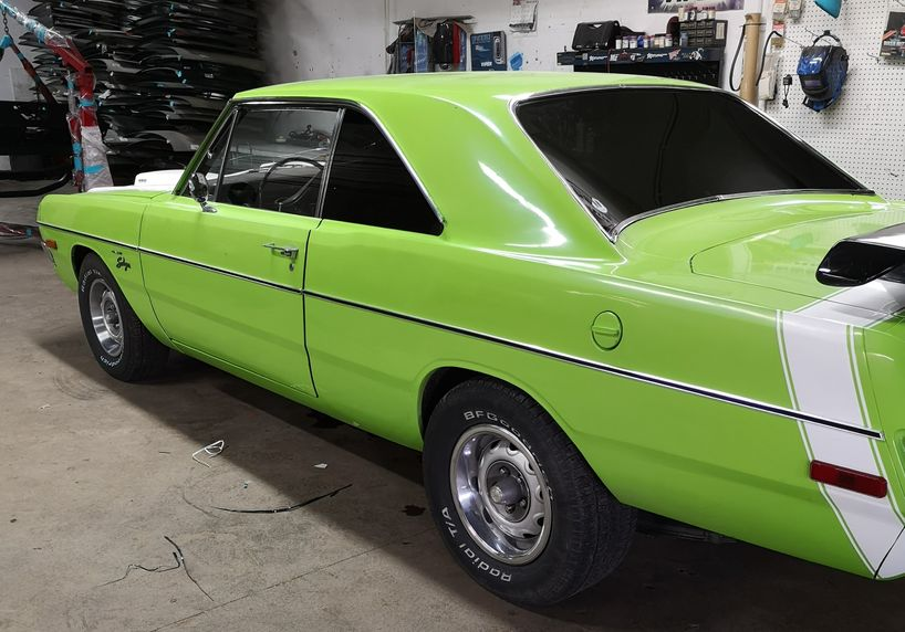 Green car with window tints